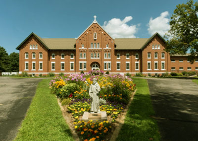 Front Entrance, St. Francis Statue in Forefront